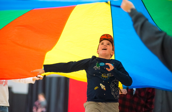 Billy Kieffer, 11, of Lewisburg, laughs and smiles while running underneath a parachute during the Special Needs Family Fun Day on Saturday at the Miller Center in Lewisburg.