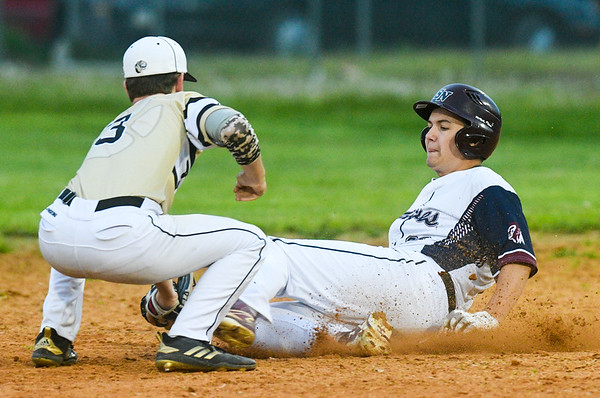 Southern Columbia's Ronnie Zsido catches Shikellamy's Wyatt Faust for an out during Friday night's game.
