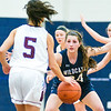 Mifflinburg's Reagan Griffith guards Loyalsock's Juliana Cruz as she brings the ball down the court during Wednesday night's HAC tournament game in Sunbury.