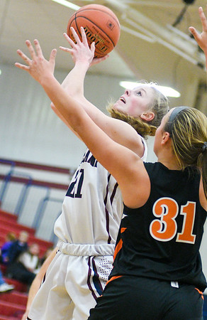Shikellamy's Tori Smith shoots over Jersey SHore's Sadie Grisworld during Tuesday night's game in Sunbury.