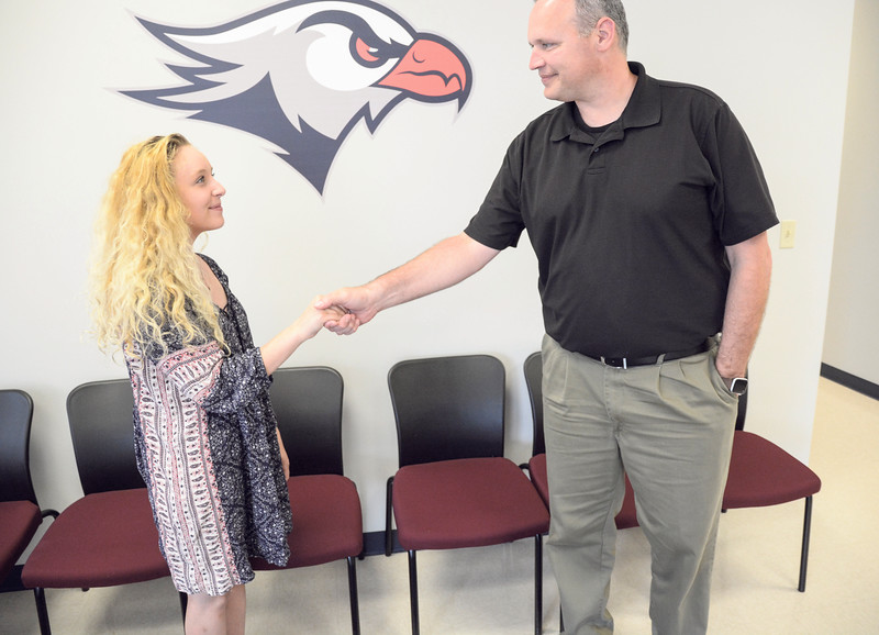 Robert Inglis/The Daily Item  Prospective Lackawanna College Sunbury branch potential student Haley Dorman, Sunbury, meets with director Philip Campbell on Thursday afternoon.