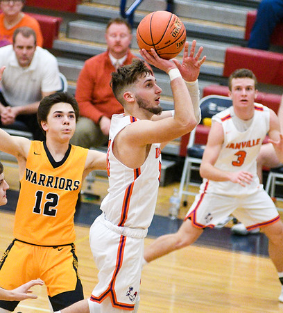 Danville's Peyton Riley shoots after going by Montoursville's Peyton Mussina during Thursday's HAC semifinal game in Sunbury.