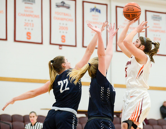 Susquehanna's Madi Welliver shoots over Drew's Sarah Henig and Erin Frederick during Wednesday night's game in Selinsgrove.