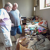 Robert Inglis/The Daily Item  SRI board member Slade Shreck, left, and Sunbury city councilman Jim Eister, look over things that will be for sale Friday and Saturday at the Albright Center in Sunbury.