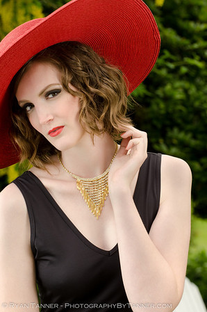 This is a product shot for a local store, showcasing the hat, jewelery, and dress.   Model: Jessica Hair/Makeup: Stacey Lowe Creative Director: Gabrielle