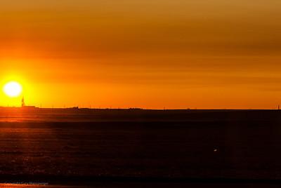 Sun set over a Proton rocket launch site.