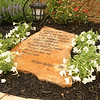 The meditation garden was created in honor of the late Sister Geraldine Hedinger. This rock is inscribed with one of the works of Sister Geraldine.