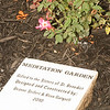 A garden stone that reads: Meditation Garden, Gifted to the Sisters of St. Benedict, Designed and Constructed by: Deanne Seifert & Reen Gutgsell, 2010
