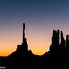 Pre-dawn silhouettes of the Totem Pole and Yei Bi Chei.