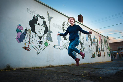 Grace Carroll (cq) senior pictures. Senior at Cleveland High School with MacKenzie Broderick and Ariana Stewart. Photographed with Oscar Wilde and the rest of the mural at SE 33rd. and Hawthorne Tuesday 11/20/12.  © 2012 Fred Joe / www.fredjoephoto.com