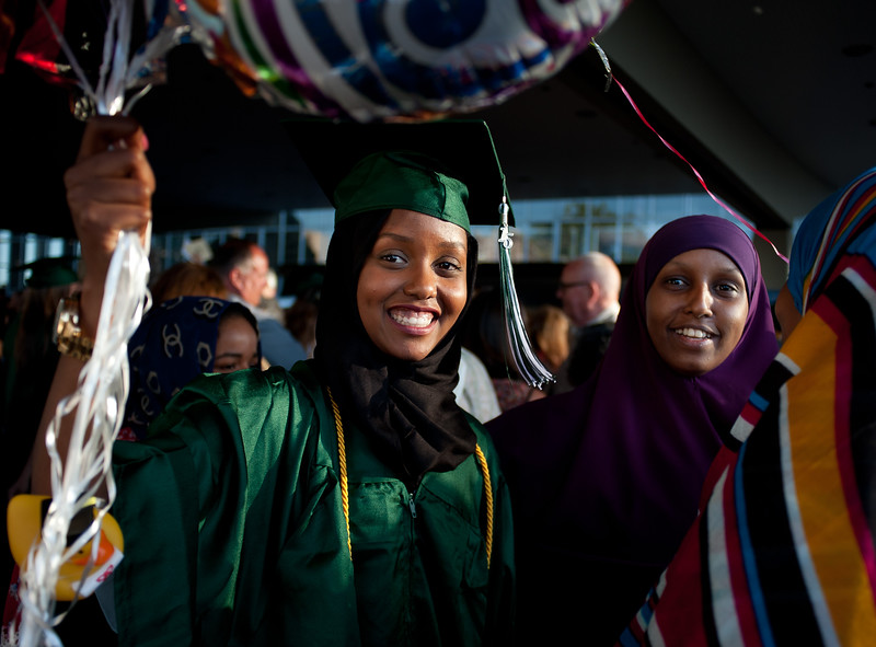 """Graduating seniors from Wilson High School and Madison High School got their diplomas in separate commencement ceremonies at Veteran's Memorial Coliseum Wednesday June 10, 2015. Wilson grads in green robes and Madison students in red or blue (their choice). © 2015 Portland Public Schools  /  <a href=""""http://www.fredjoephoto.com"""">http://www.fredjoephoto.com</a>"""