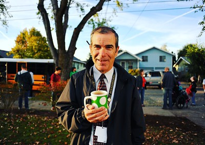 All Hands Raised APAD 2015, Thursday October 15, 2015. Roosevelt High School Vice Principal, Dan Malone, on the lawn greeting students Thursday morning.  © 2015  Fred Joe Photo | www.fredjoephoto.com