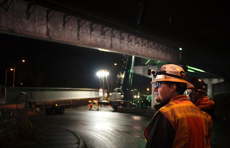 """Workers from Capital Concrete, Axis Crane and Stacy & Witbeck closed the Tacoma Street off ramp from Northbound McLoughlin Blvd Friday night 12/7/12. During the closure they installed a span of 4 girders, each weighing more than 100,000 lbs and measuring about 140 feet in length.  Capital Concrete used their Moon Glo Work Light system to provide safe glare free lighting to the site © 2012 TriMet / Fred Joe / <a href=""""http://www.fredjoephoto.com"""">http://www.fredjoephoto.com</a>"""