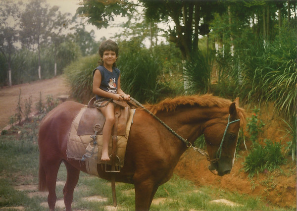 I was about 6 or 7. This picture was taken the same day as my dad's last one.<br /> Love the hair and confidence on the big horse.