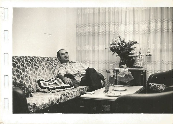My newlywed dad comfy on his sofa. <br /> He used to be the one taking the pictures in our family.