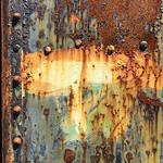 Rusty painted door on old bunker, Fort Flagler, WA USA
