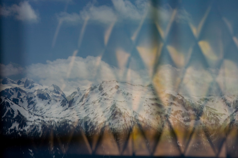 Olympic Mountains reflection in window