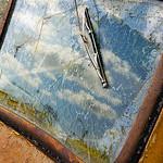 Sky reflection in old truck windshield, Sprague, WA USA