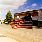 Window reflection of American flag, Sprague, WA USA