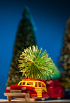 Antique toy car carrying Christmas Tree
