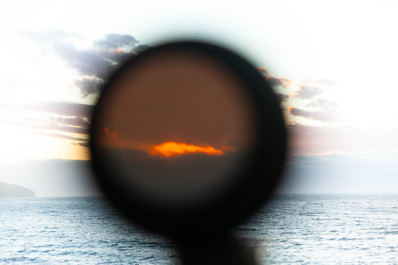 Sun setting  over ocean through telescope. Strait of Juan de Fuca, WA