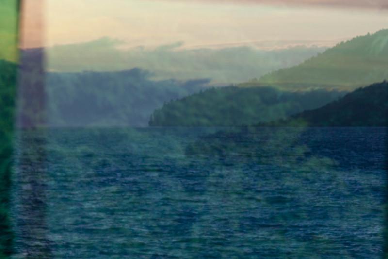 Window reflection over Freshwater Bay