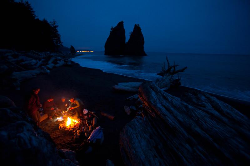 Backpackers by coastal campfire, Olympic NP, La Push, WA