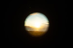 Sunset through telescope, Strait of Juan de Fuca, WA