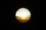Sunset through telescope, Strait of Juan de Fuca, WA