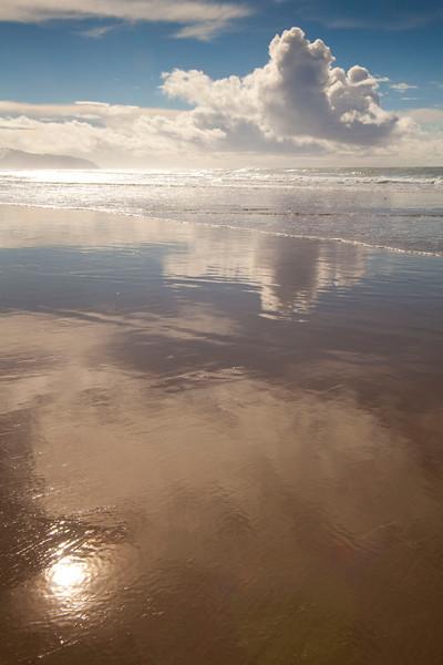 Sky reflection in shoreline, Oregon