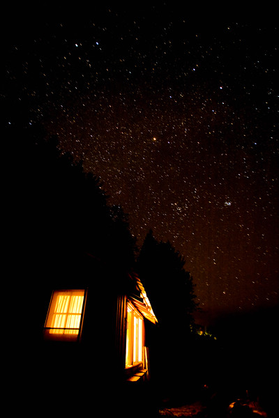 Cabin at night seen from outside, Stars above, Whiskey Creek Resort, Joyce, WA USA