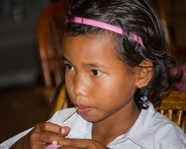 Girl Sipping Through Straw