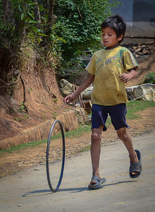 Boy Playing with Hoop
