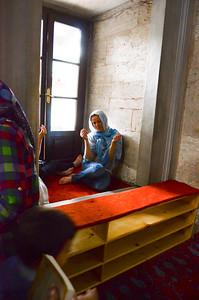 Woman Praying at Mosque