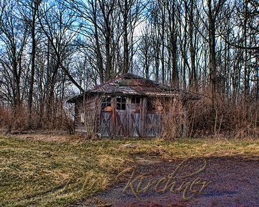 "This photo, ""along the forgotten road""  is certainly a favorite.  Only this aging old garage remains on this property and takes on some beautiful coloring during the weathering process."