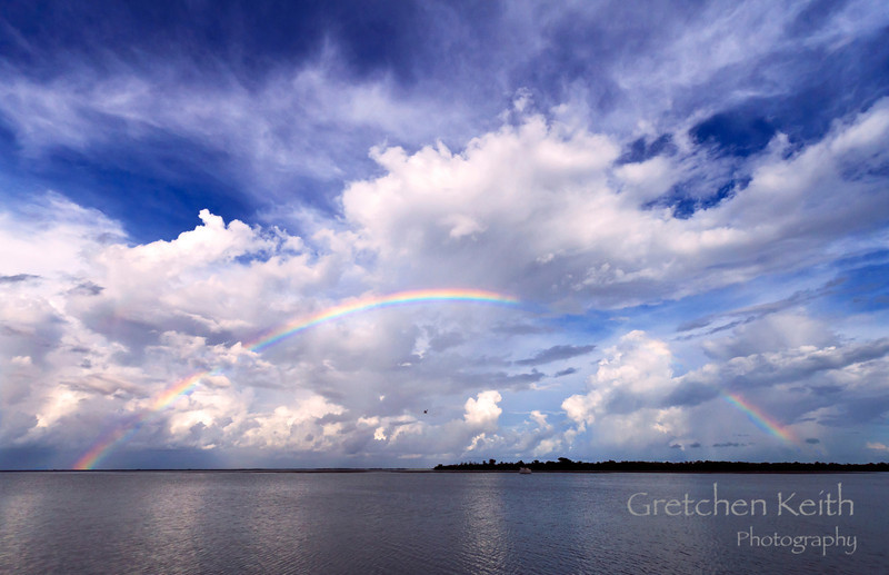 Somewhere Over the Rainbow<br /> (Taken on Captiva Island, just outside the Green Flash restaurant. There was actually a double rainbow partially visible for a short while and manatees played in the water below.)