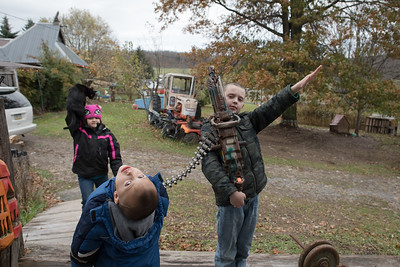 11/2/2017. Ulysses, PA. USA. Dresysen (right) gives a Sieg Heil statue while his brother and sister look on.   In 2013, a year after Dresysen's parents gave birth to their second child diagnosed with autism, they started reading about National Socialism. The couple felt the diagnosis of both children was somehow related to man-made influences, such as hydraulic fracturing and mandatory immunizations for children attending public school. The ideology of National Socialism fell in line with their core beliefs and quickly became part of their daily lives.   Today, they remain outspoken members of the White Nationalist movement and have eight children ranging from 6-months to nine, four have been diagnosed with autism.  This particular salute was adopted in the 1930's by the Nazi party as a sign of obedience to the party leader Adolf Hitler. The salute is considered a criminal offense in several counties, most notably Germany, Switzerland, Austria, Canada, France, Sweden and Russia.