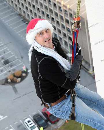 Brian Cashman, General Manager of the New York Yankees rappels from one of Stamford, CT's tallest buildings,