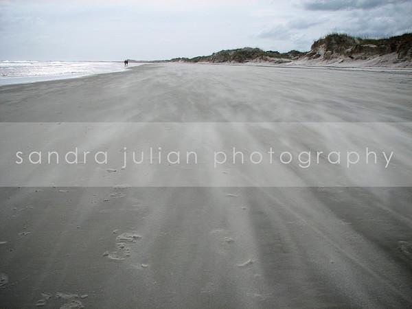 BLOWING BEACH SAND