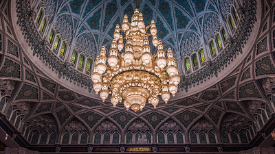 Sultan Qaboos Grand Mosque. The chandelier is located in the center of the men's prayer hall and measures a staggering 14 meters and weighs 8,5 tons. It holds 600,000 shining bright Swarovski crystals, 24 carat gold plating and took more than four years to complete.