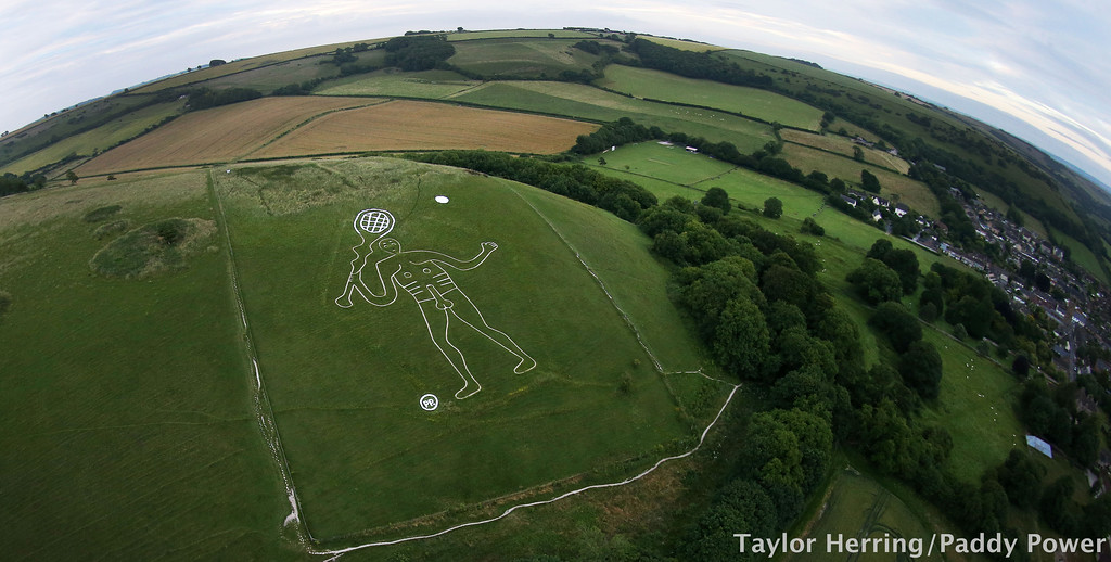 Cerne Abbas Giant holding tennis racket, Dorset, UK, 3rd July 2017