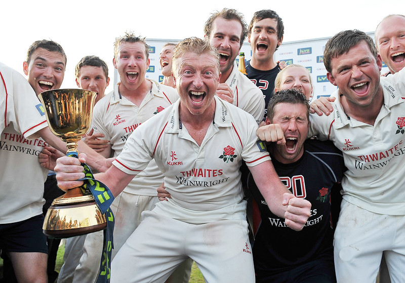 Cricket - LV County Championship - Somerset vs. Lancashire - County Ground, Taunton<br /> Captain Glen Chapple celebrates with the championship trophy having taken Lancashire to their first outright first-class county championship title since 1934.