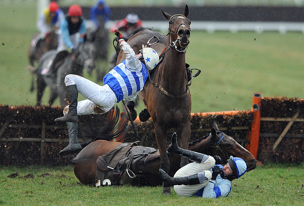 Horse Racing Cheltenham Festival 2010 Day 4, Cheltenham Racecourse 19/03/2010. Credit: Dan Rowley/Colorsport The Albert Bartlett Novices' Hurdle Race Jockey Henry Oliver lies on the ground with his horse Restless Harry who fell at the last hurdle as Fionnegas unseats jockey D J Casey over the top of them
