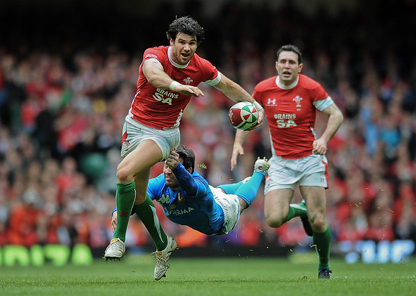 Mike Phillips of Wales is dramatically tackled by Craig Gower of Italy during their RBS Six Nations match at the Millennium Stadium, Cardiff Wales. Wales won the match 33-10.