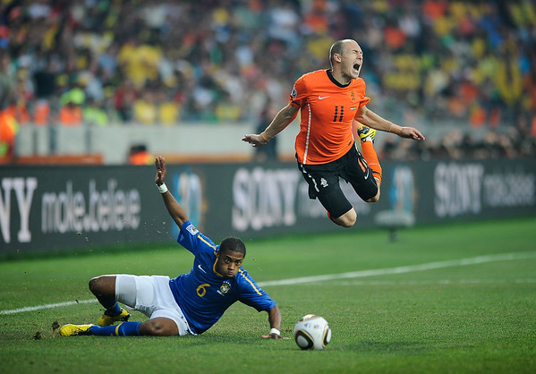 Football - 2010 FIFA World Cup - Brazil vs Netherlands Michel Bastos of Brazil fouls Arjen Robben of the Netherlands leading to their first goal from the free kick at the Nelson Mandela Bay Stadium, Port Elizabeth