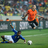 Football - 2010 FIFA World Cup - Brazil vs Netherlands<br /> Michel Bastos of Brazil fouls Arjen Robben of the Netherlands leading to their first goal from the free kick at the Nelson Mandela Bay Stadium, Port Elizabeth
