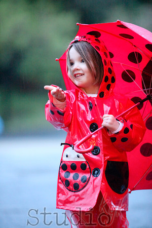 bring an umbrella and rain boots...  KYK  LOVES the rain!