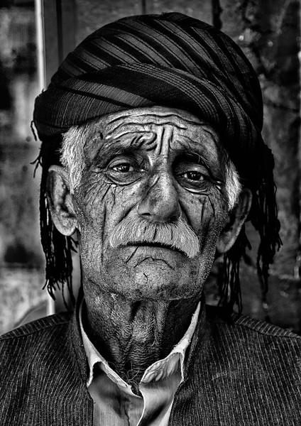 Old Kurdish man with grungy skin