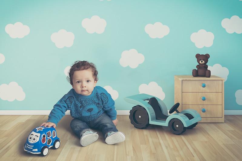 Small boy in his cartoon room