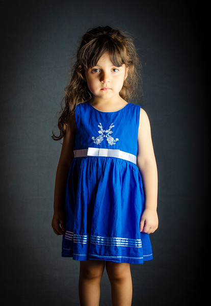 Small Girl Standing in front of textured background